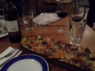 Delicious sausage pizza and local wine